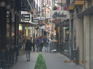 Calle Rúa had lots of stores. The Sporting Goods store is just past the store on the right.