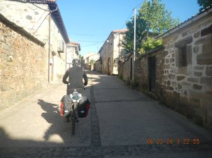 Cyclist making his way through Rabanal