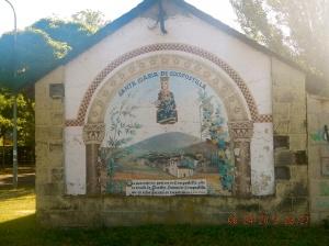 Mural on the side of the Ermita Santa María in Compostilla