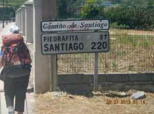 Sue by the sign telling us that we still had quite a way until we reached Santiago.