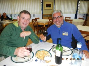 Robert and I - two happy peregrinos having dinner at the Restaurante El Volante. We have extra big smiles because of the wine and the second serving of chips (French fries)!