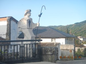 The statute of the peregrino that shows you the way to Santiago.