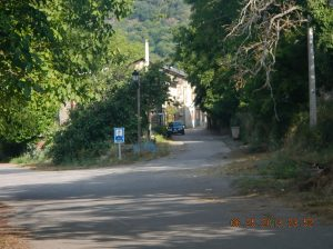 The entrance to a village of Pereje where we saw much evidence of the timber industry in this region.