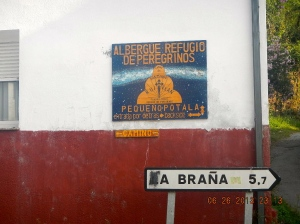 "An example of a sign written in Spanish that has been altered to Galician. So mysteriously this sign in Ruitelán changed from ""La Braña"" to ""A Braña"" Galician nationalism asserting itself on the border."