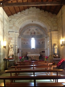 Notice its Romanesque altar (one of the few Romanesque altars left in Galicia)